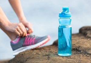 running shoe and water bottle